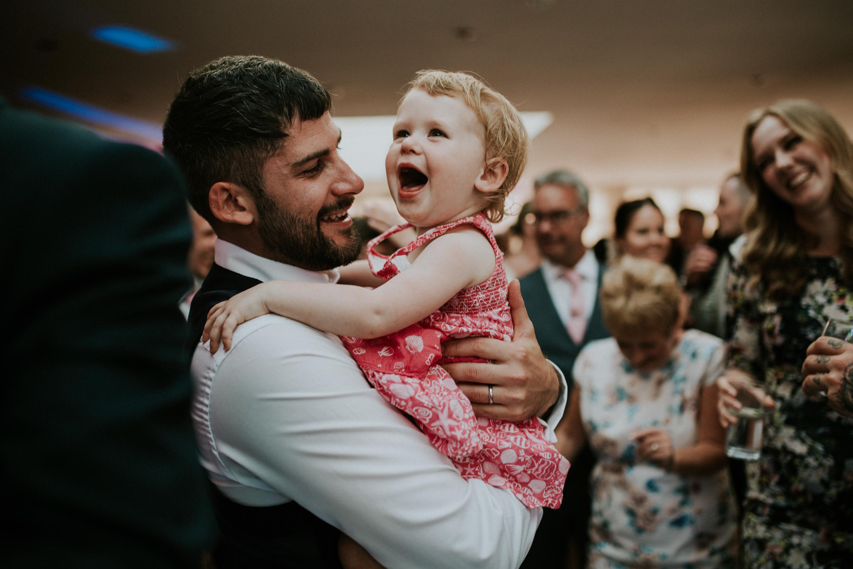 groom and little girl