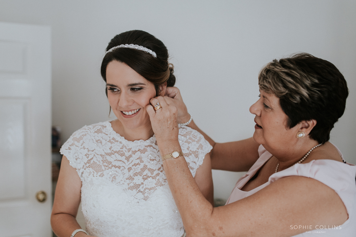 mother doing brides earrings