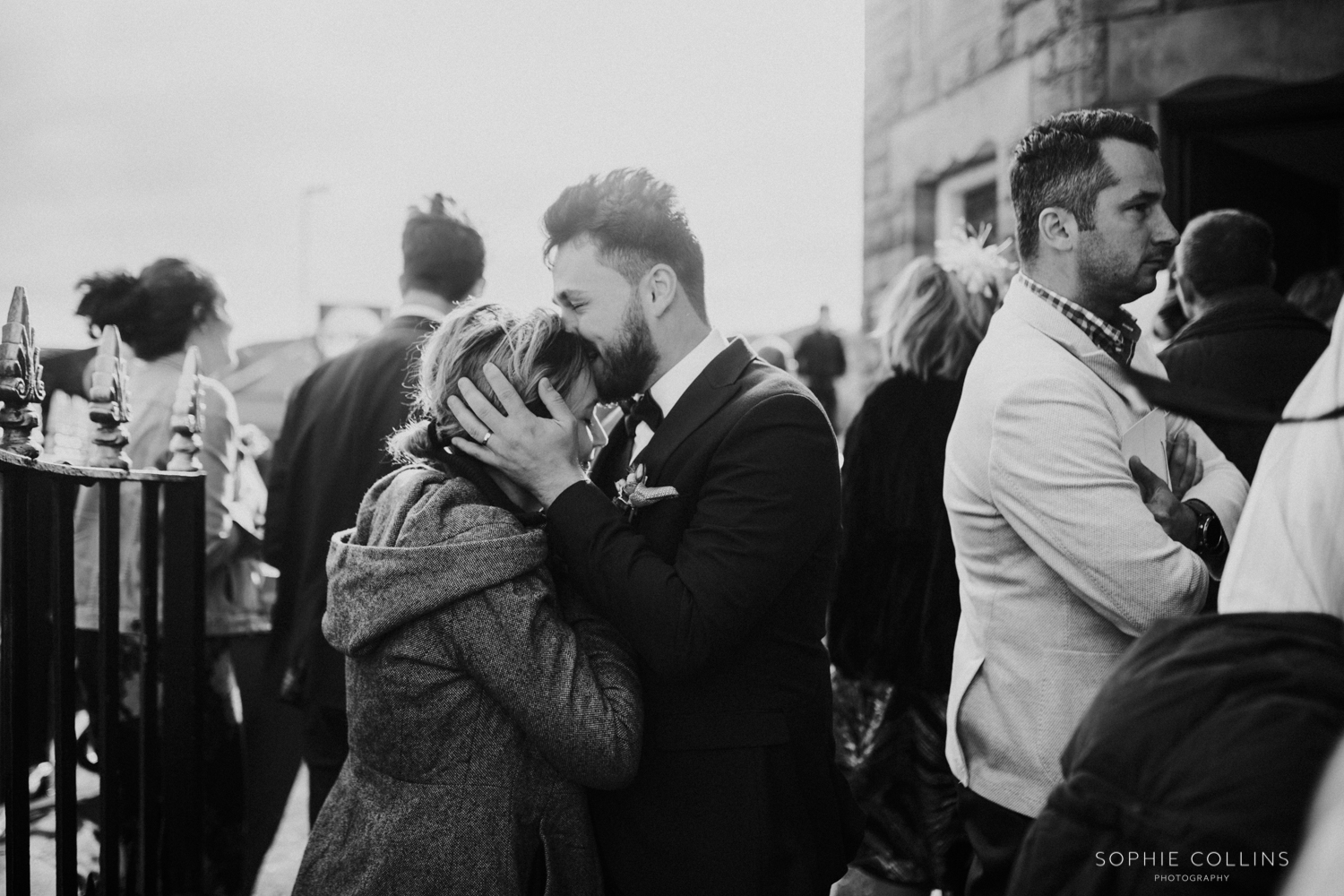 groom kissing someones head
