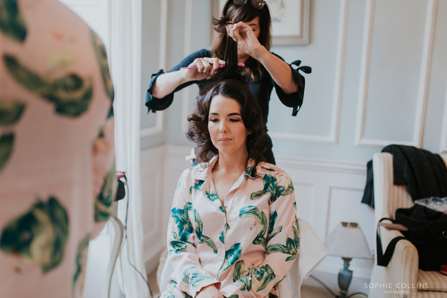 bridesmaid having her hair done
