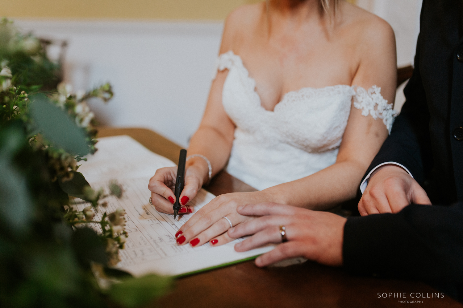 close up signing the register