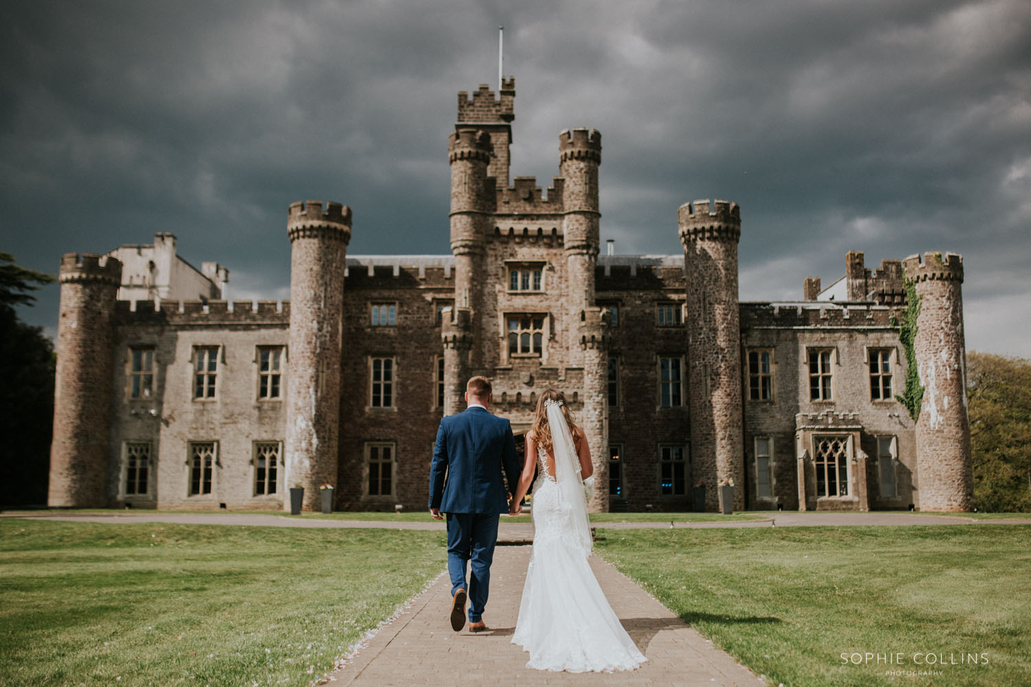 bride and groom outside the castle